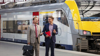 People outdoor Two generation of Businessmen talking. Train. Station.