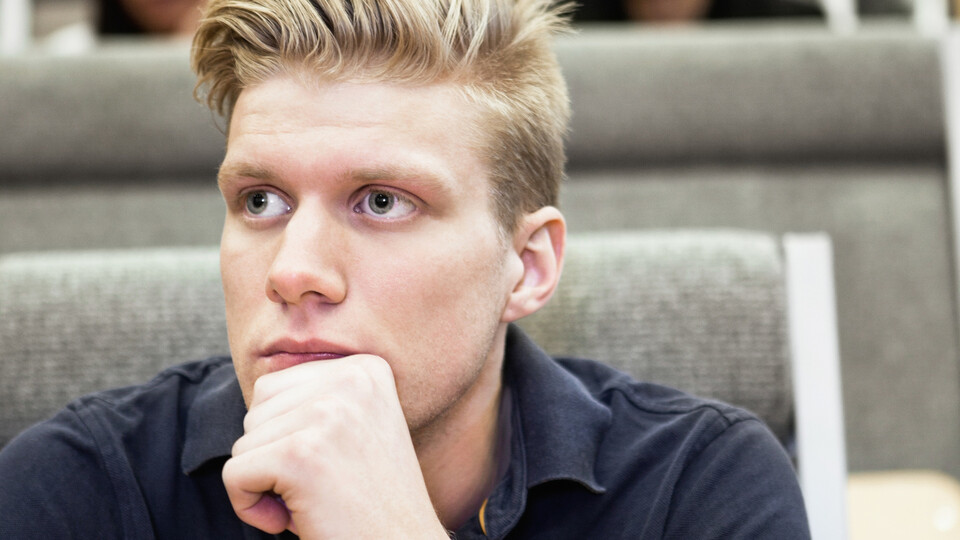 Close up of  young man concentrating on seminar. People, school, indoor, concentration.