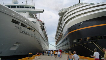 Two cruise ships in dock.