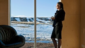 Woman looking at snowy landscape