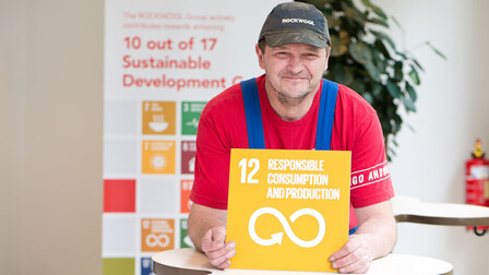An employee holding Sustainable Development Goal #12: Responsible Consumption and Production for the #iRockGlobalGoals campaign. Keywords: Sustainable Development Goals, SDGs, Global Goals, Sustainability, Employees, Employee, Colleague, Colleagues