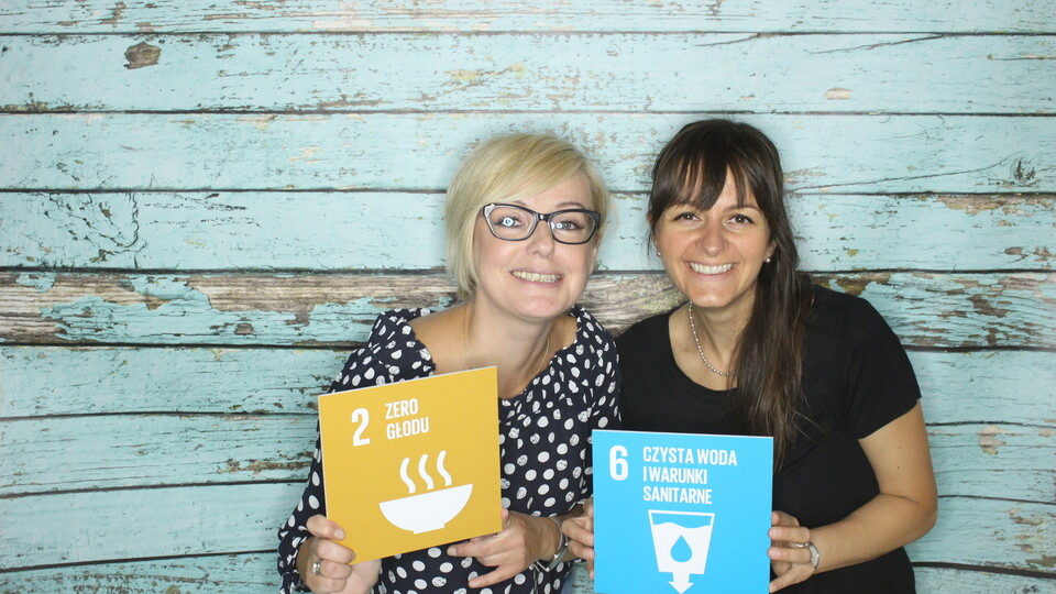 Two employees holding Sustainable Development Goals signs for the #iRockGlobalGoals campaign. Keywords: Keywords: Sustainable Development Goals, SDGs, Global Goals, Sustainability, Employees, Employee, Colleague, Colleagues