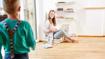 single family home, mother and son, indoor, woman sitting on floor, cosiness, woman working at home, DIY image,  germany,