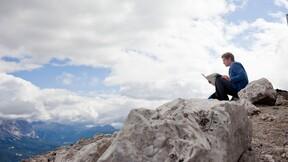 Man on mountain, rock, sitting