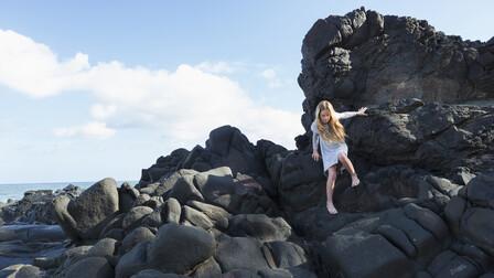 Girl climbing rocks