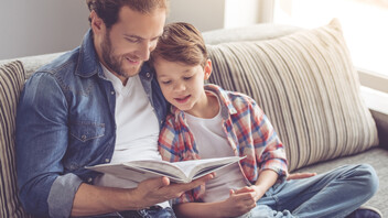 Father and son reading