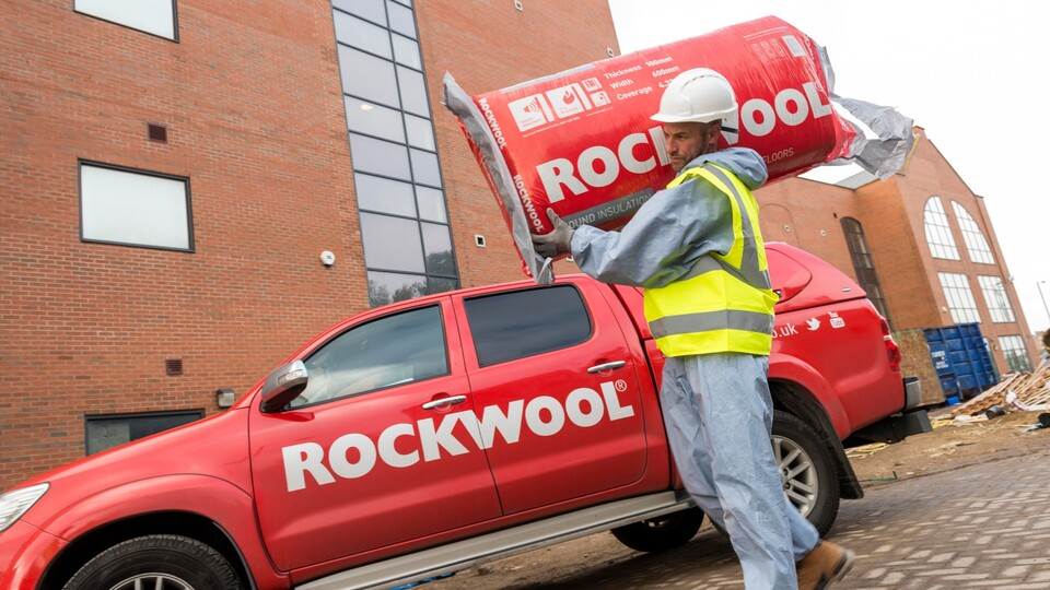 Utility Wise project - Installer carrying ROCKWOOL insulation on shoulder