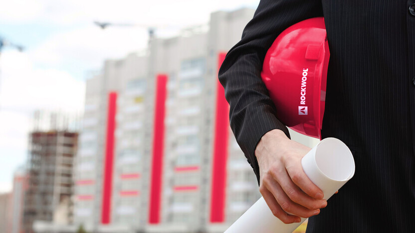 Contractor with ROCKWOOL red hardhat