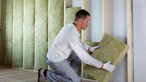 Man installing insulation, Self-builder, Renovation, Timber Frame Wall